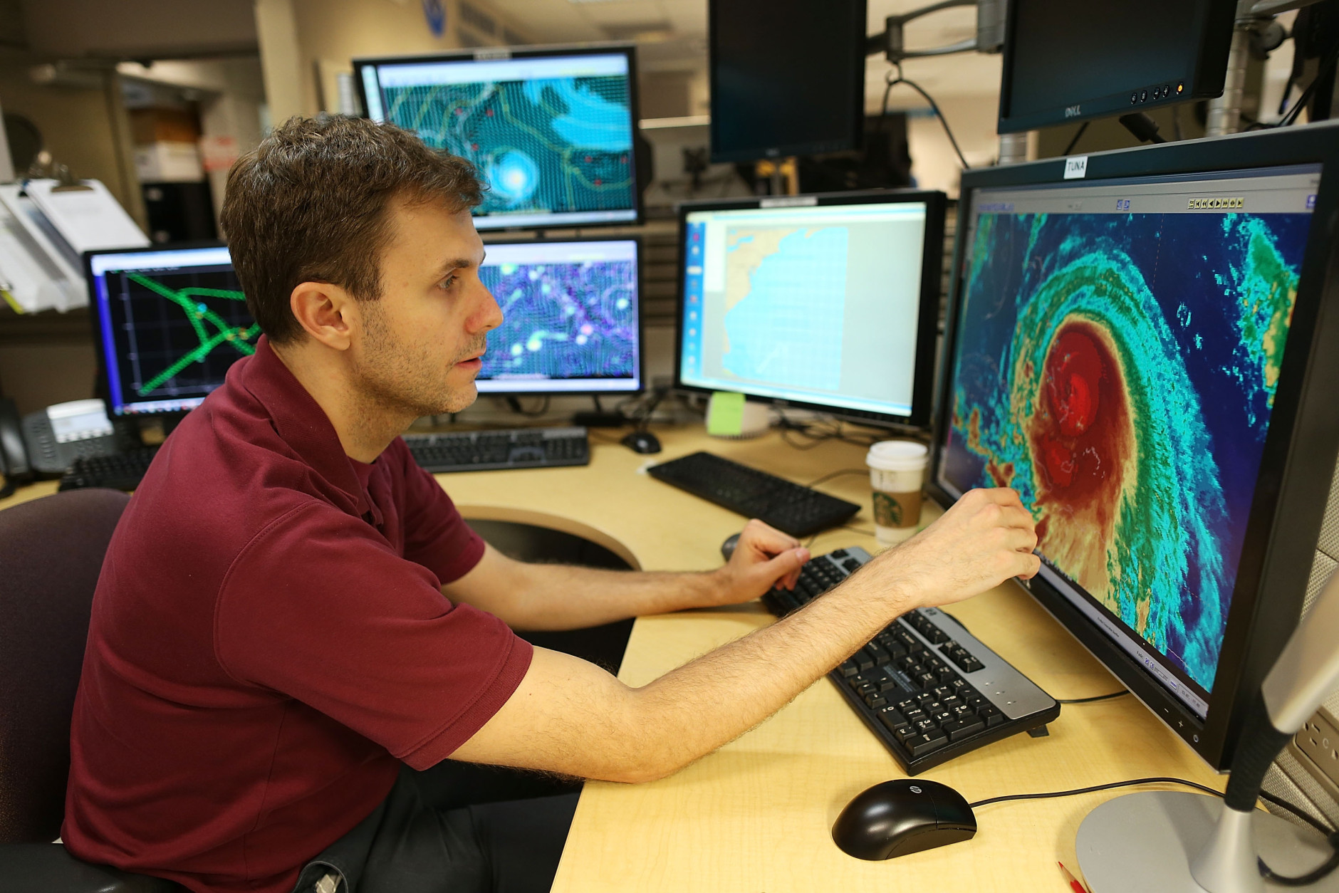 MIAMI, FL - OCTOBER 01:  Eric Blake, Hurricane Specialist, uses a computer at the National Hurricane Center to track the path of Hurricane Joaquin, a Category 3 storm with maximum sustained winds of 125 mph, as it passes over parts of the Bahamas on October 1, 2015 in Miami, Florida. The National Hurricane Center forecasters are still trying to determine if the hurricane will turn to the north and northwest, which might affect the U.S. East Coast.  (Photo by Joe Raedle/Getty Images)