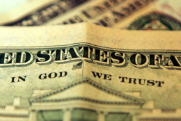 """LONDON, UNITED KINGDOM - OCTOBER 23: In this photo illustration the phrase """"In God We Trust""""  can be seen on an American ten dollar bill on October 23, 2008 in London, England. The British pound has hit it's lowest point against the Dollar in five years as it fell to just above 1.62 US Dollars after fears of a recession were acknowledged by the government and financial experts today.  (Photo by Hugh Pinney/Getty Images)"""
