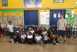 CW Harris Elementary School students pose for a picture with Mr. Richards, the P.E. teacher. (WTOP/Kate Ryan)