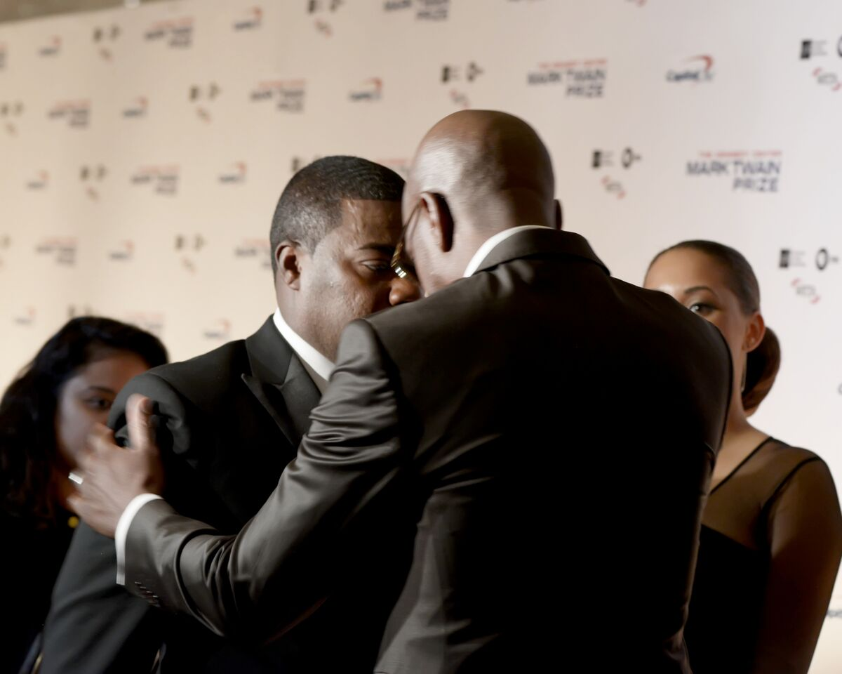 JB Smoove embraces Tracy Morgan on the red carpet on Oct. 18, 2015. (Courtesy Shannon Finney, www.shannonfinneyphotography.com)