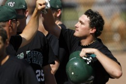 Jacksonville's Daniel Murphy, right, is congratulated by teammates after hitting an BRI double during an NCAA regional baseball game against Sacred Heart, Saturday, June 3, 2006, in Athens, Ga. (AP Photo/Todd Bennett)