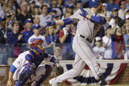 New York Mets' Lucas Duda hits a three-run home run during the first inning of Game 4 of the National League baseball championship series against the Chicago Cubs Wednesday, Oct. 21, 2015, in Chicago. (AP Photo/David J. Phillip)