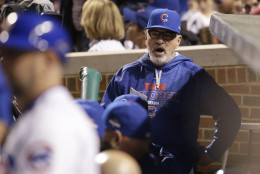 Chicago Cubs manager Joe Maddon talks to players in the dugout during the second inning of Game 4 of the National League baseball championship series against the New York Mets Wednesday, Oct. 21, 2015, in Chicago. (AP Photo/Nam Y. Huh)