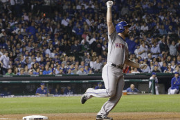 New York Mets' Daniel Murphy rounds first after hitting a home run during the eighth inning of Game 4 of the National League baseball championship series against the Chicago Cubs Wednesday, Oct. 21, 2015, in Chicago.  (AP Photo/David J. Phillip)