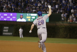 New York Mets' Daniel Murphy celebrates after hitting a two-run home run during the eighth inning of Game 4 of the National League baseball championship series against the Chicago Cubs Wednesday, Oct. 21, 2015, in Chicago. (AP Photo/David J. Phillip)