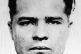 "**ADVANCE FOR MONDAY FEB 2** Charles ""Pretty Boy"" Floyd is shown in this 1932 photo, location not known. On the centennial of  Floyd's birth, the notorious bank robber and mass murderer is still remembered as a Robin Hood in his home states of Oklahoma and Arkansas, celebrated in pop culture and credited with bringing the FBI to prominence.  Floyd is immortalized in gangster lore and FBI records for the Kansas City Massacre of June 17, 1933, when he and another man shot two Kansas City police officers,two FBI agents and Frank Nash, a criminal Floyd was trying to spring from federal custody. (AP Photo/file)"