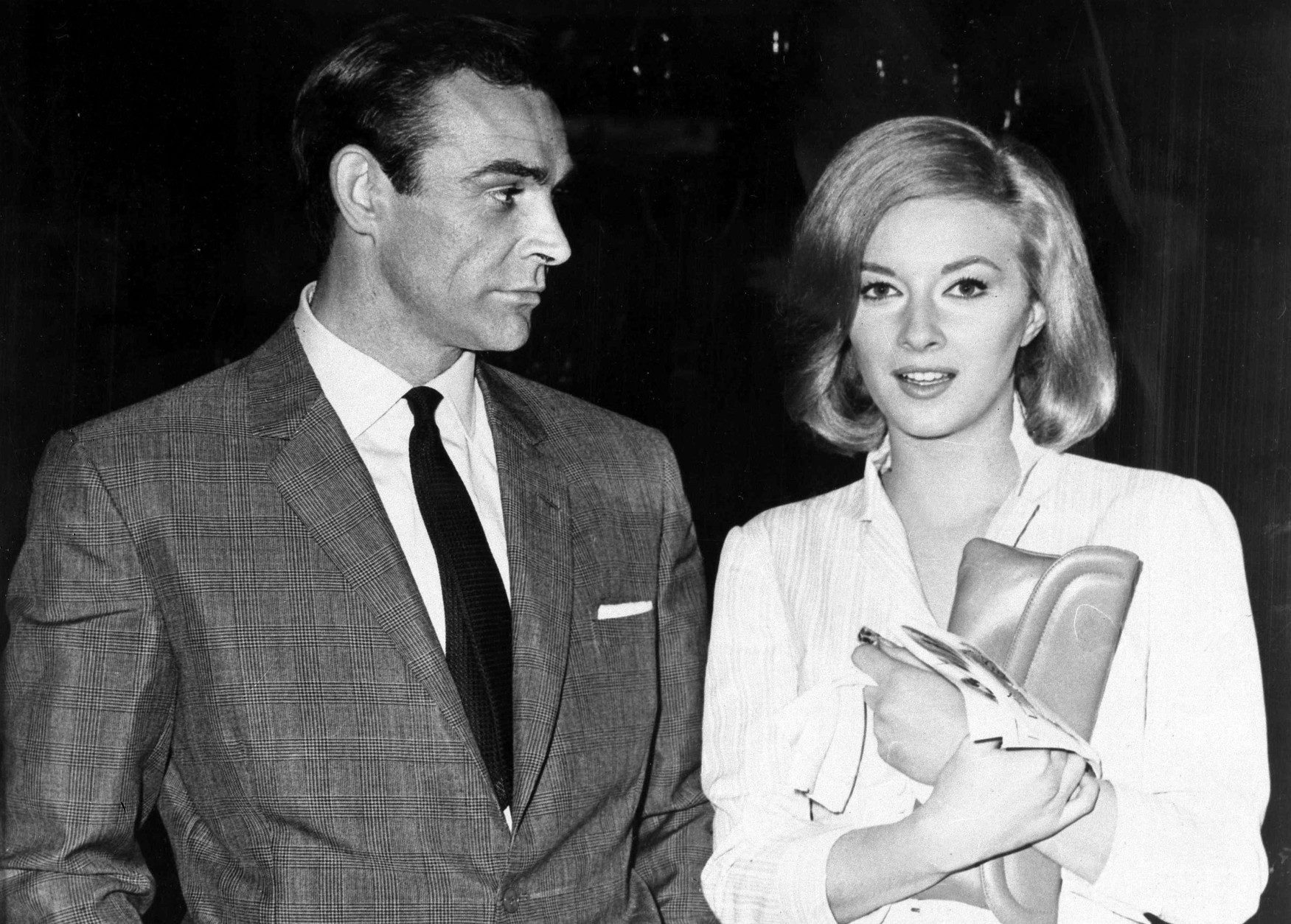 "File - In this Apr. 25, 1963 file photo, Sean Connery and Italian actress Daniela Bianchi are seen in Istanbul, Turkey. The pair were in the country filming the second Bond film, 'From Russia with Love.' Connery was playing the British secret agent for the second time in what many critics consider to be one of the best Bond film of all. His suave but menacing Bond remains the standard for many Bond fans. The upcoming new Bond film ""Spectre"" starring Daniel Craig has its World Premiere on Monday Oct. 26, 2015, in London.(AP Photo, File)"
