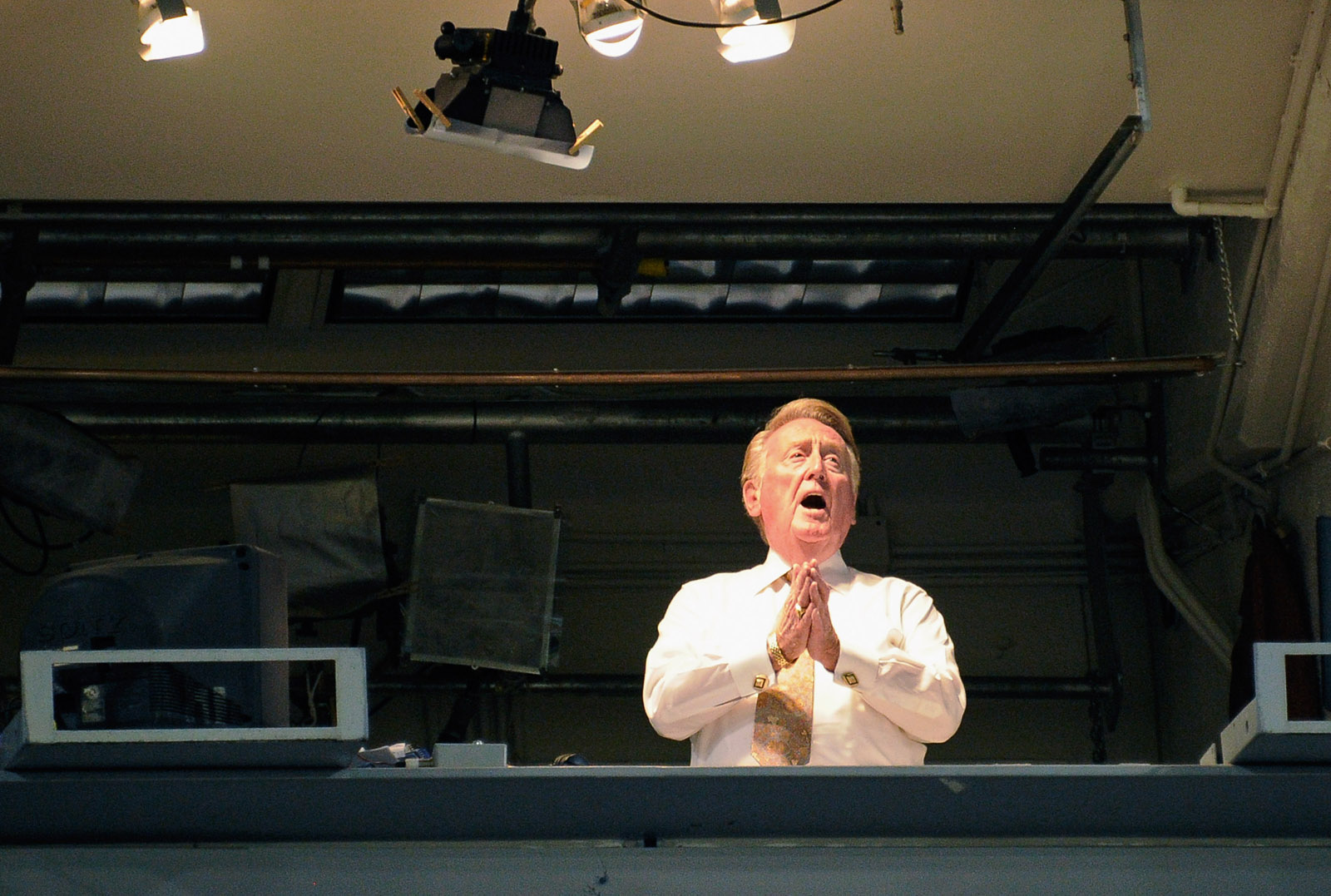 """LOS ANGELES, CA - SEPTEMBER 14: Vin Scully the play-by-play voice of the Los Angeles Dodgers sings """"Take Me Out to the Ball Game"""" song, which has become the unofficial anthem of baseball, during the seventh inning of the baseball game between the Arizona Diamondbacks and the Los Angeles Dodgers at Dodger Stadium on September 14, 2011 in Los Angeles, California.  (Photo by Kevork Djansezian/Getty Images)"""
