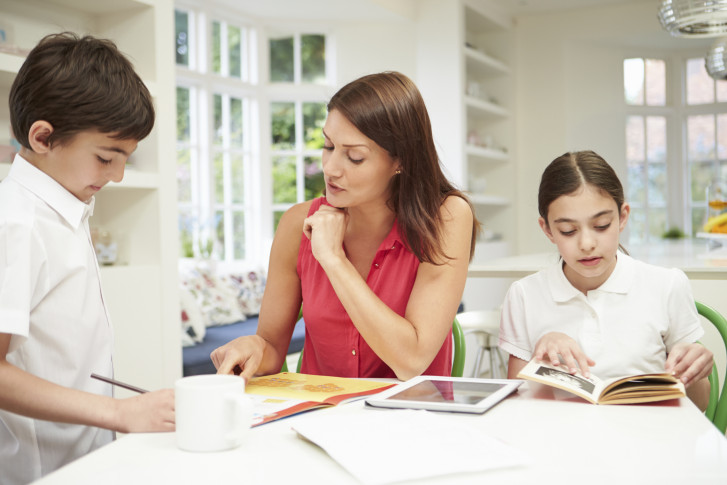 Blog   AAA Scholarship Foundation United Kingdom   Netau net Children doing homework for school together helping each other Stock Photo