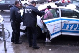 Photo of Erica Ufie being arrested in New York City
