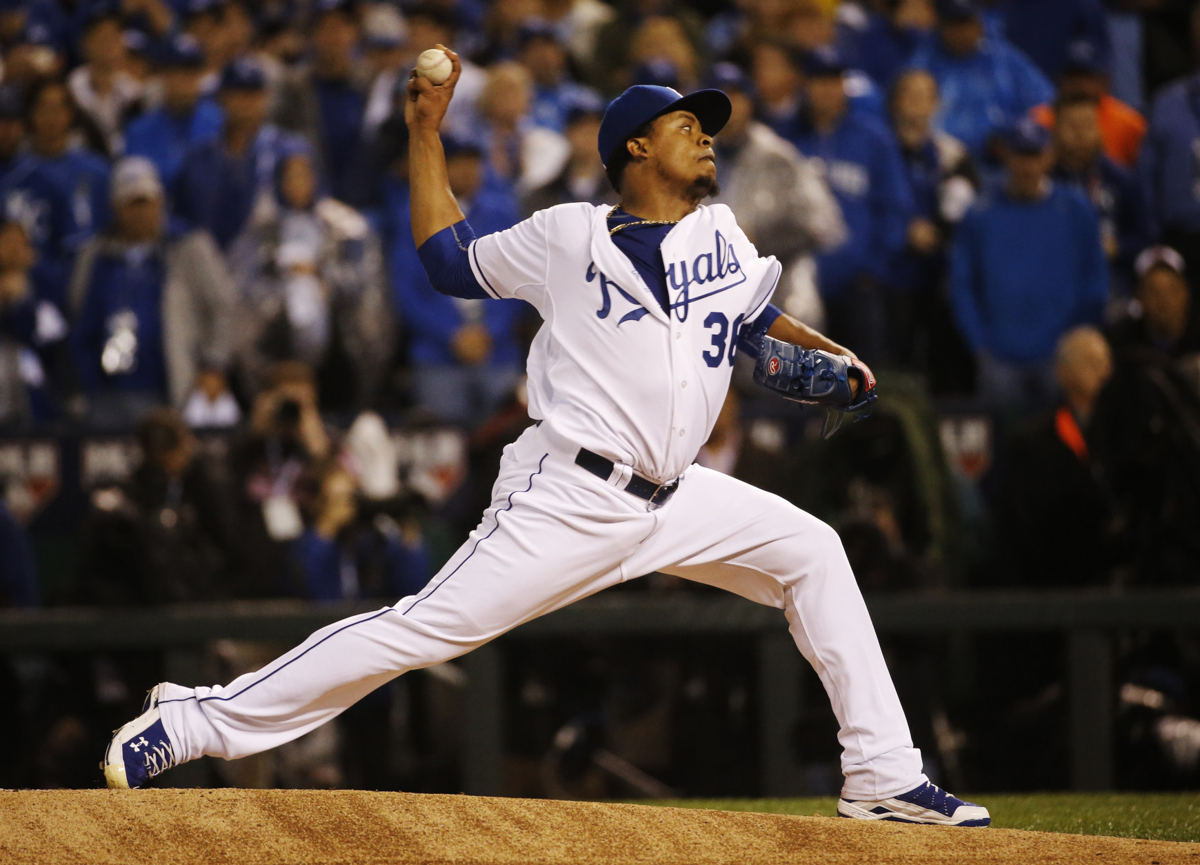 Kansas City Royals pitcher Edinson Volquez throws during the first inning of Game 1 of the Major League Baseball World Series against the New York Mets Tuesday, Oct. 27, 2015, in Kansas City, Mo. (AP Photo/Matt Slocum)