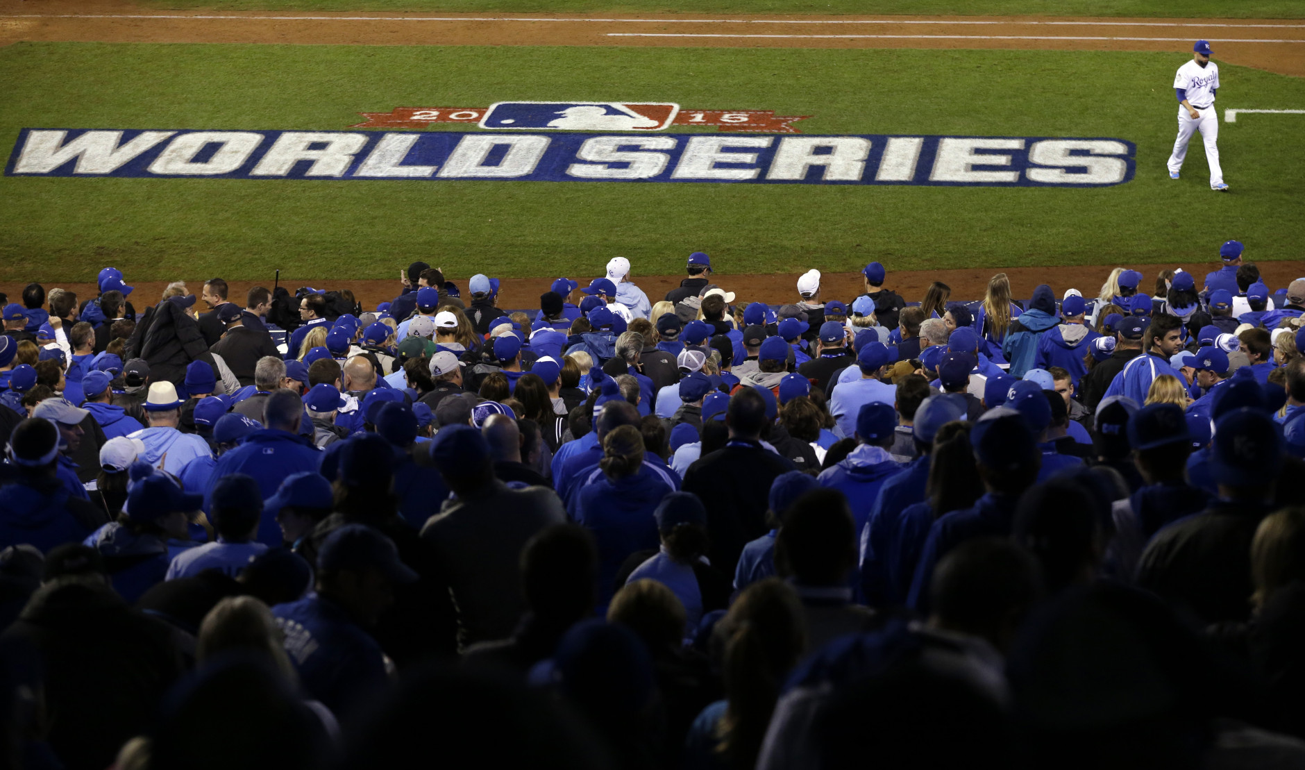 Kansas City Royals pitcher Kelvin Herrera walks back to dugout after the New York Mets scored a run during the eighth inning of Game 1 of the Major League Baseball World Series Tuesday, Oct. 27, 2015, in Kansas City, Mo. (AP Photo/David Goldman)