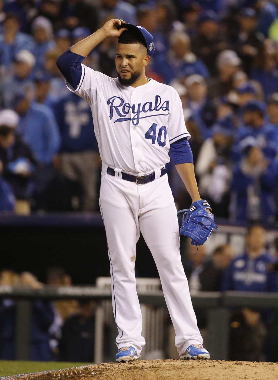 Kansas City Royals pitcher Kelvin Herrera looks at the scoreboard during the eighth inning of Game 1 of the Major League Baseball World Series against the New York Mets Tuesday, Oct. 27, 2015, in Kansas City, Mo. (AP Photo/Matt Slocum)