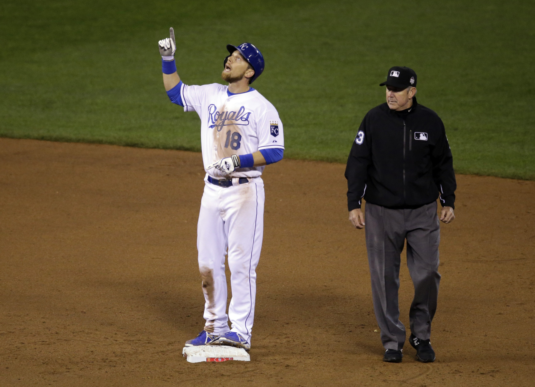 Kansas City Royals' Ben Zobrist reacts after hitting a double during the eighth inning of Game 1 of the Major League Baseball World Series against the New York Mets Tuesday, Oct. 27, 2015, in Kansas City, Mo. (AP Photo/David Goldman)