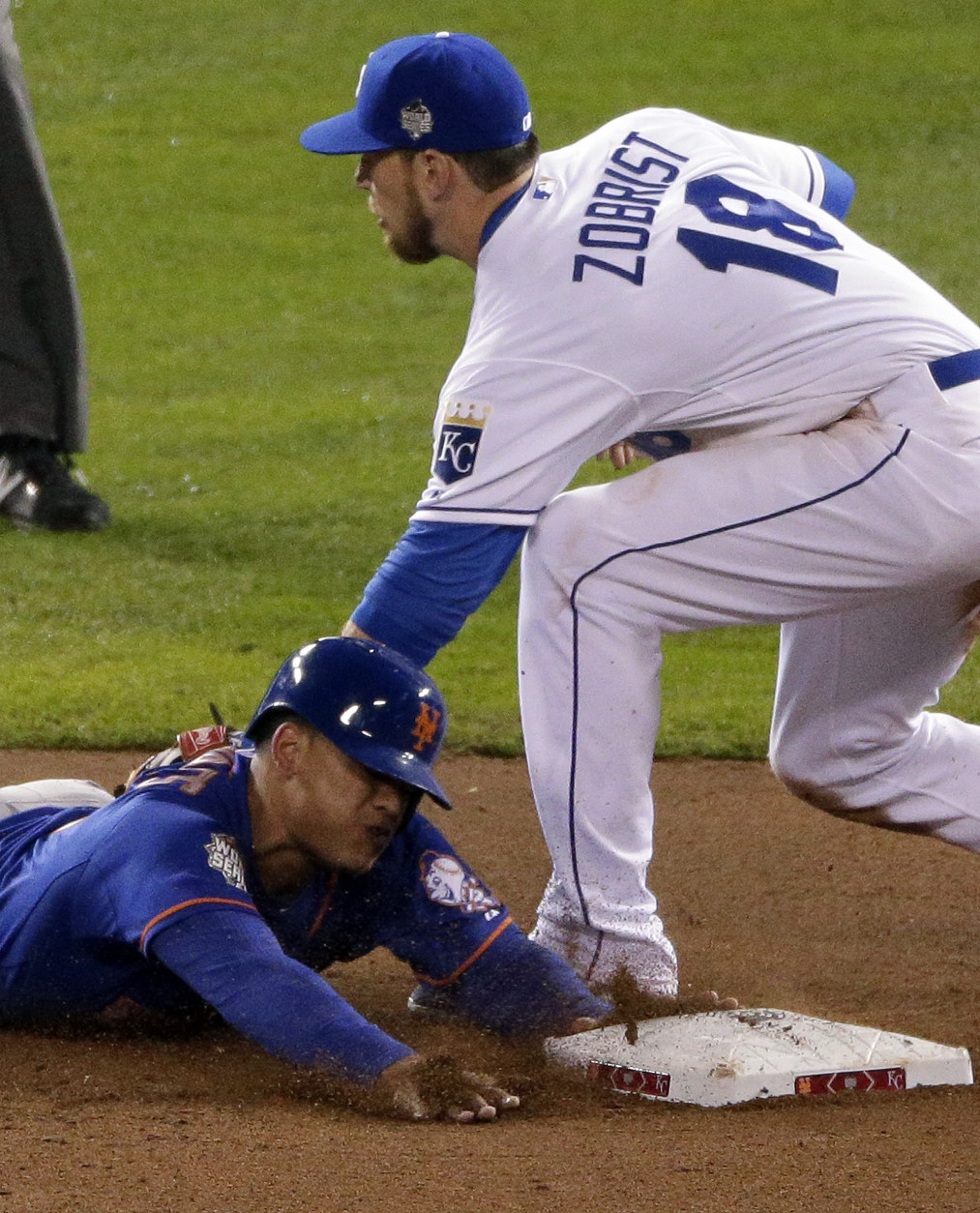 New York Mets' Juan Lagares, left, steals second base past Kansas City Royals second baseman Ben Zobrist during the eighth inning of Game 1 of the Major League Baseball World Series Tuesday, Oct. 27, 2015, in Kansas City, Mo. (AP Photo/Charlie Riedel)