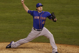 New York Mets pitcher Addison Reed pitches during the seventh inning of Game 1 of the Major League Baseball World Series against the Kansas City Royals Tuesday, Oct. 27, 2015, in Kansas City, Mo. (AP Photo/Orlin Wagner)