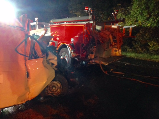 Driver hits fire truck intentionally blocking lanes