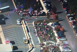 Students are seen outside of W.T. Woodson High School where a fire occurred. (Courtesy NBC Washington)