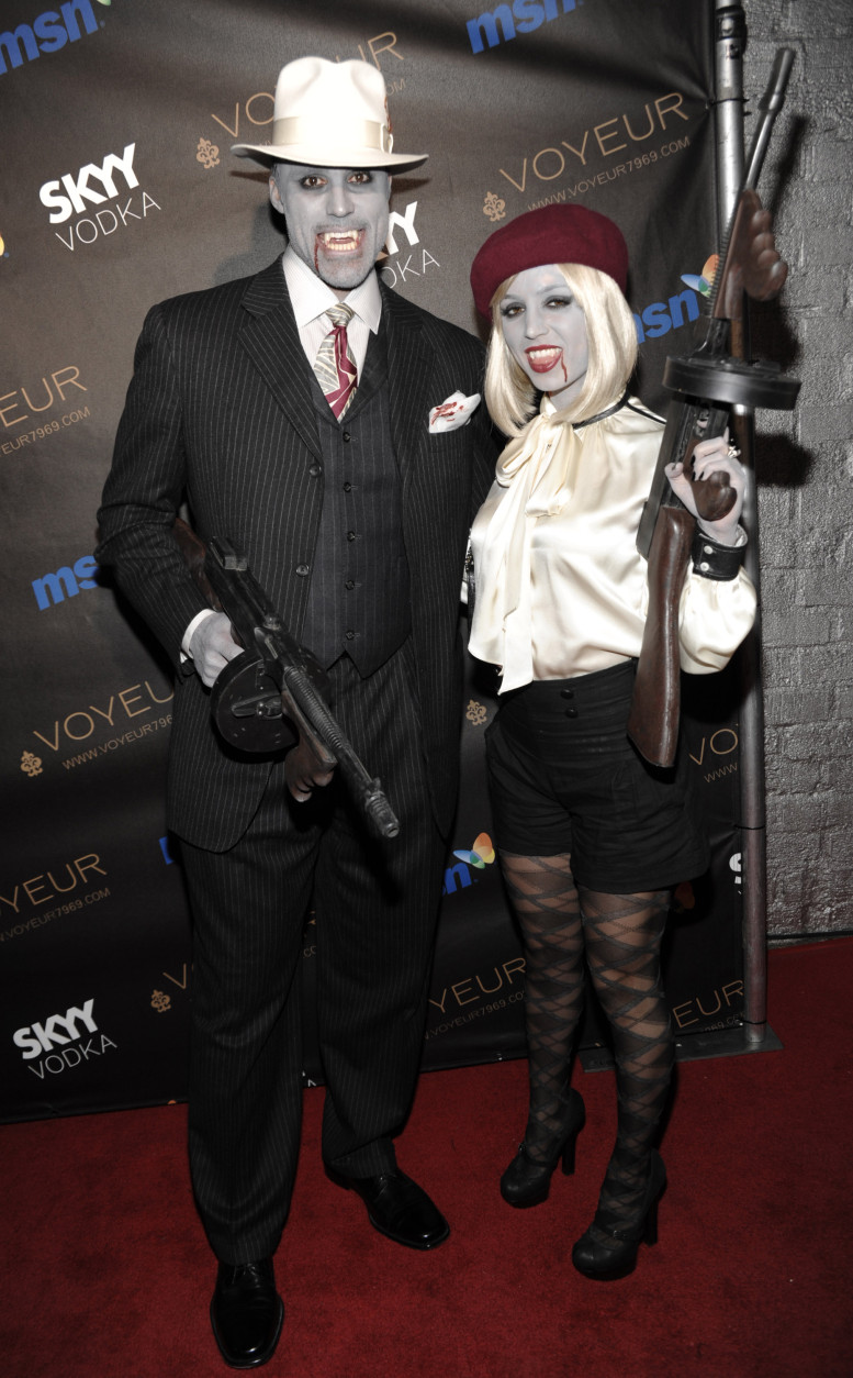 Actor Rick Fox, left, and actress Eliza Dushku arrive at Heidi Klum's 10th annual Halloween party in West Hollywood, Calif. on Saturday, Oct. 31 , 2009. (AP Photo/Dan Steinberg)