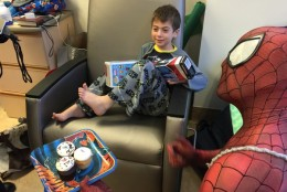 Jake says he wants out of the hospital, but enjoys the visit during this year's Hope For Henry Superhero Extravaganza. (WTOP/Kristi King)