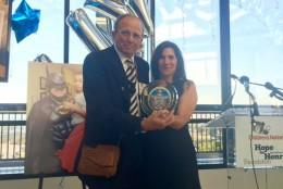 "Larry Robinson, father of late Lenny ""Batman"" Robinson, gets the Hope for Henry Superhero Award. (WTOP/Kristi King)"