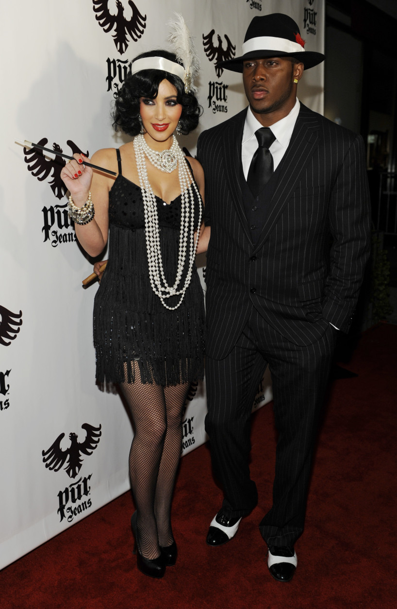 Kim Kardashian and her boyfriend, NFL player Reggie Bush, arrive for the Pur Jeans Halloween Bash in Los Angeles, Friday, Oct. 31, 2008. (AP Photo/Chris Pizzello)