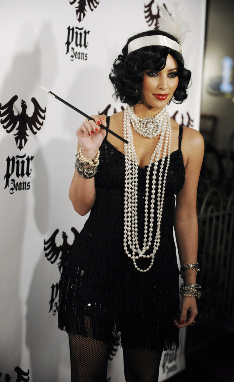 Kim Kardashian arrives for the Pur Jeans Halloween Bash in Los Angeles, Friday, Oct. 31, 2008. (AP Photo/Chris Pizzello)