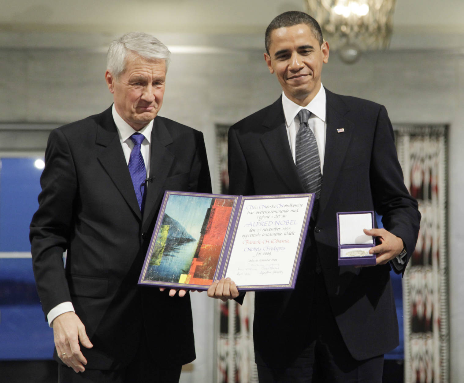 FILE - In this Dec. 10, 2009, file photo, President and Nobel Peace Prize laureate Barack Obama poses with his medal and diploma alongside Nobel committee chairman Thorbjorn Jagland at the Nobel Peace Prize ceremony at City Hall in Oslo, Norway. (AP Photo/John McConnico, File)