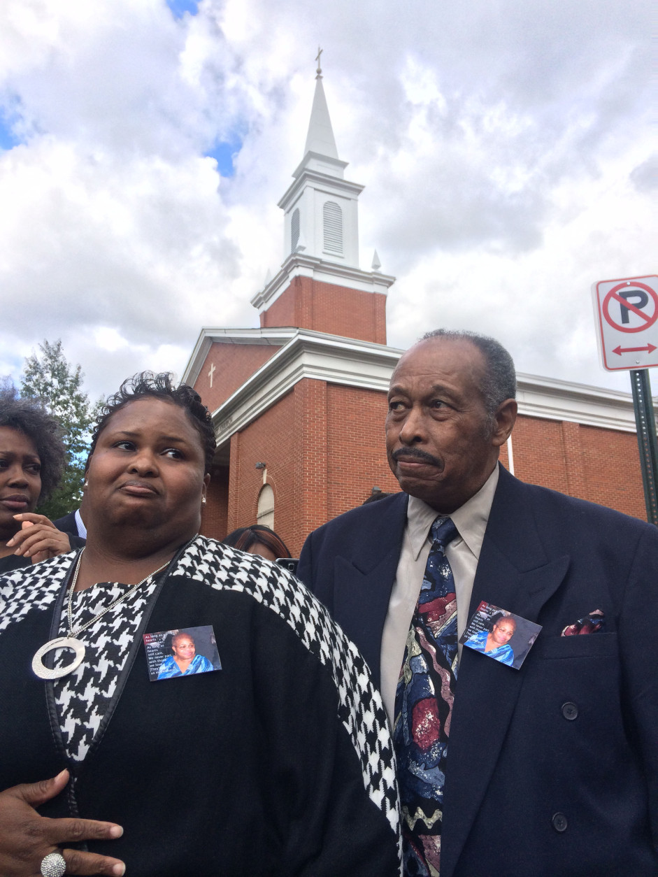 A new street sign unveiled at New Samaritan Baptist Church in D.C. was named for the late Ruby Whitfield, who was struck and killed by a motorist while leaving the church in 2013. Her daughter, Tasha Whitfield, and husband, Thomas Whitfield, attended an official ceremony at the church Sunday, Oct. 18, 2015. (WTOP/Dick Uliano)