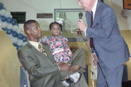 Darryl Strawberry, left, with daughter Diamond, 2 yrs., is greeted by Dodgers announcer and baseball Hall of Famer Vin Scully, Thursday, Feb. 14, 1991 in Los Angeles. Strawberry was on hand at Crenshaw High School, his alma mater, for a salute in his honor that welcomed him back to L.A. after signing a multimillion dollar contract with the Los Angeles Dodgers. (AP Photo/Julie Markes)