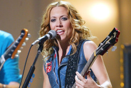 Sheryl Crow performs during the first MTV Video Music Awards Japan in Tokyo Friday night, May 24, 2002.  Sheryl Crow, Nickelback and Boys II Men and other American talent joined such Japanese stars as Rip Slyme and rapper Zeebra for the first MTV Music Awards Japan. (AP Photo/Shizuo Kambayashi)