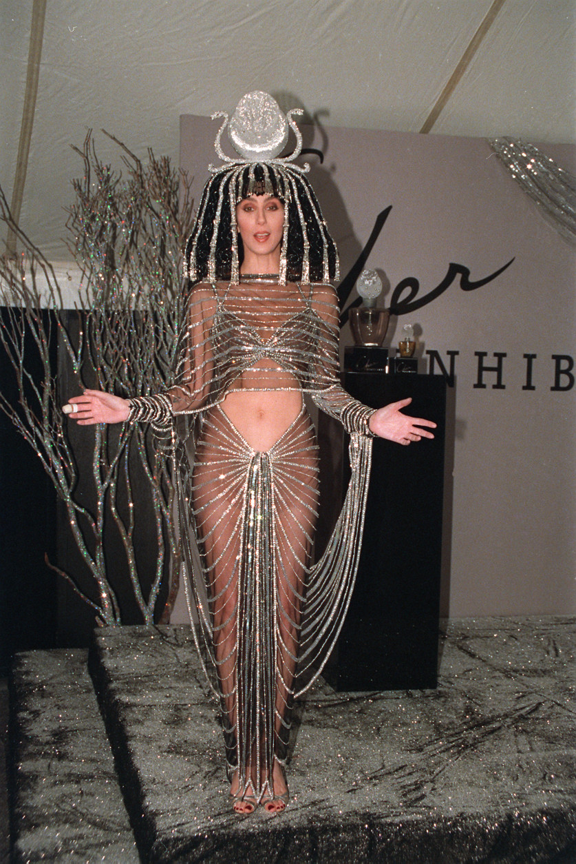 """Singer-actress Cher, dressed as an Egyptian goddess, unveils her signature scent """"Uninhibited"""" at a gala Halloween party in New York City, Monday night on Nov. 1, 1988.  (AP Photo/Gerald Herbert)"""