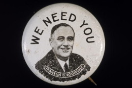 View of a campaign button promoting the presidential bid of Franklin Delano Roosevelt which features FDR's face under the text 'We Need You,' early 1930s. (Photo by Blank Archives/Getty Images)