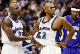 Washington Wizards' Jerry Stackhouse, center, is restrained by teammate Michael Jordan after being called for a first-quarter foul as Los Angeles Lakers' Samaki Walker stands at right Friday, Nov. 8, 2002, in Washington. (AP Photo/Ken Lambert)