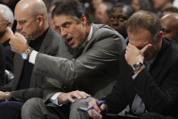 Minnesota Timberwolves head coach Randy Whitman, left, directs his squad as assistant coach Jerry Sichting reacts after a missed play against the Denver Nuggets in the first quarter of an NBA basketball game in Denver on Friday, Oct. 10, 2008. (AP Photo/David Zalubowski)