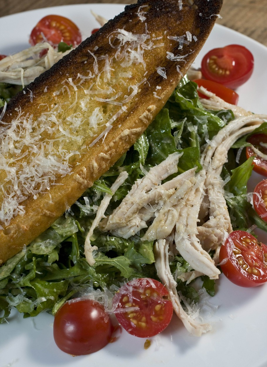Shredded Turkey and Arugula Caesar Salad With Grilled Croutons is seen in this Sunday, Oct. 26, 2008 photo.   If you are looking for a lighter take on Thanksgiving leftover meals try this Shredded Turkey and Arugula Caesar Salad With Grilled Croutons. (AP Photo/Larry Crowe)