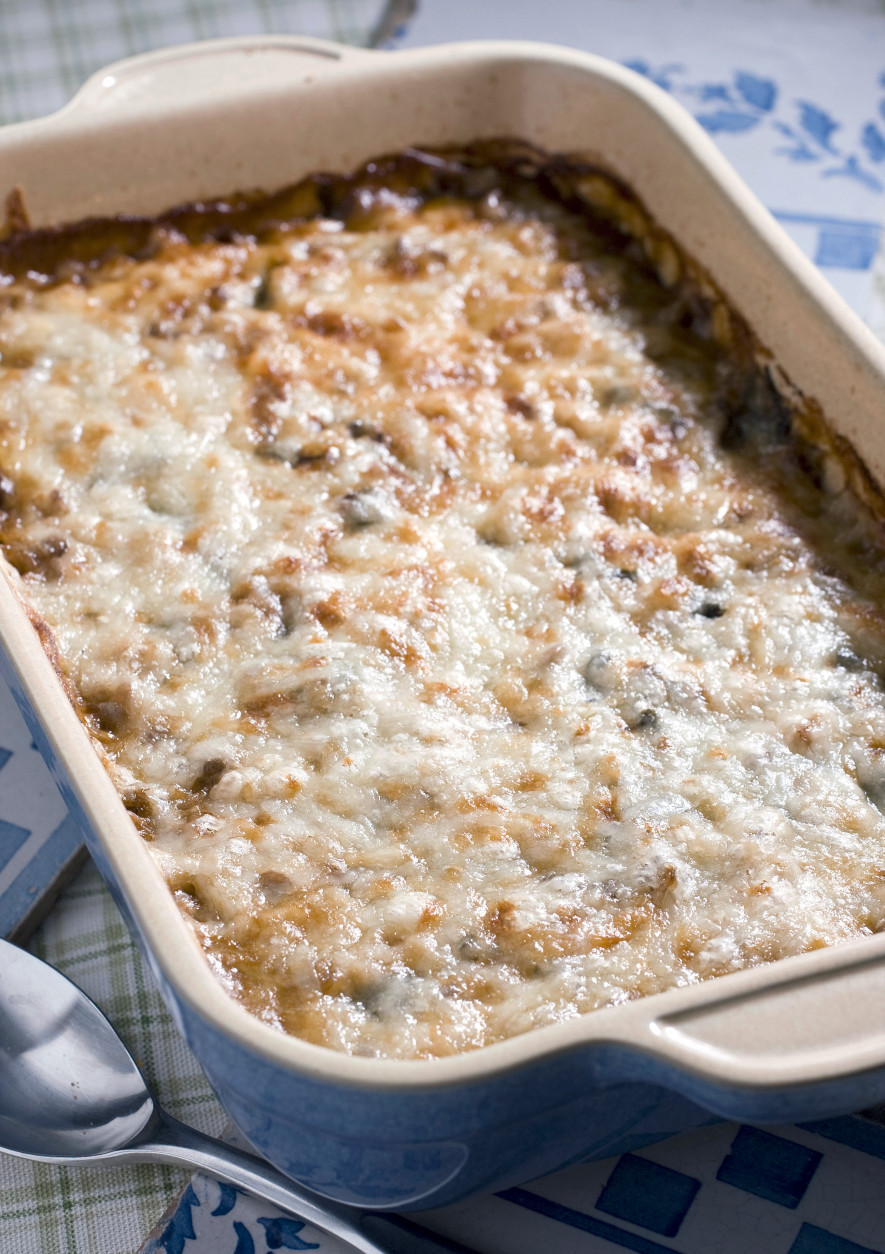 A cheesy baked lentils, rice and turkey casserole is seen in this Sept. 21, 2010 photo. Satisfy your appetite with healthy, protein rich ingredients and you may be on your way to losing weight. This casserole is full of low-fat proteins that will fill you up, not out.    (AP Photo/Larry Crowe)
