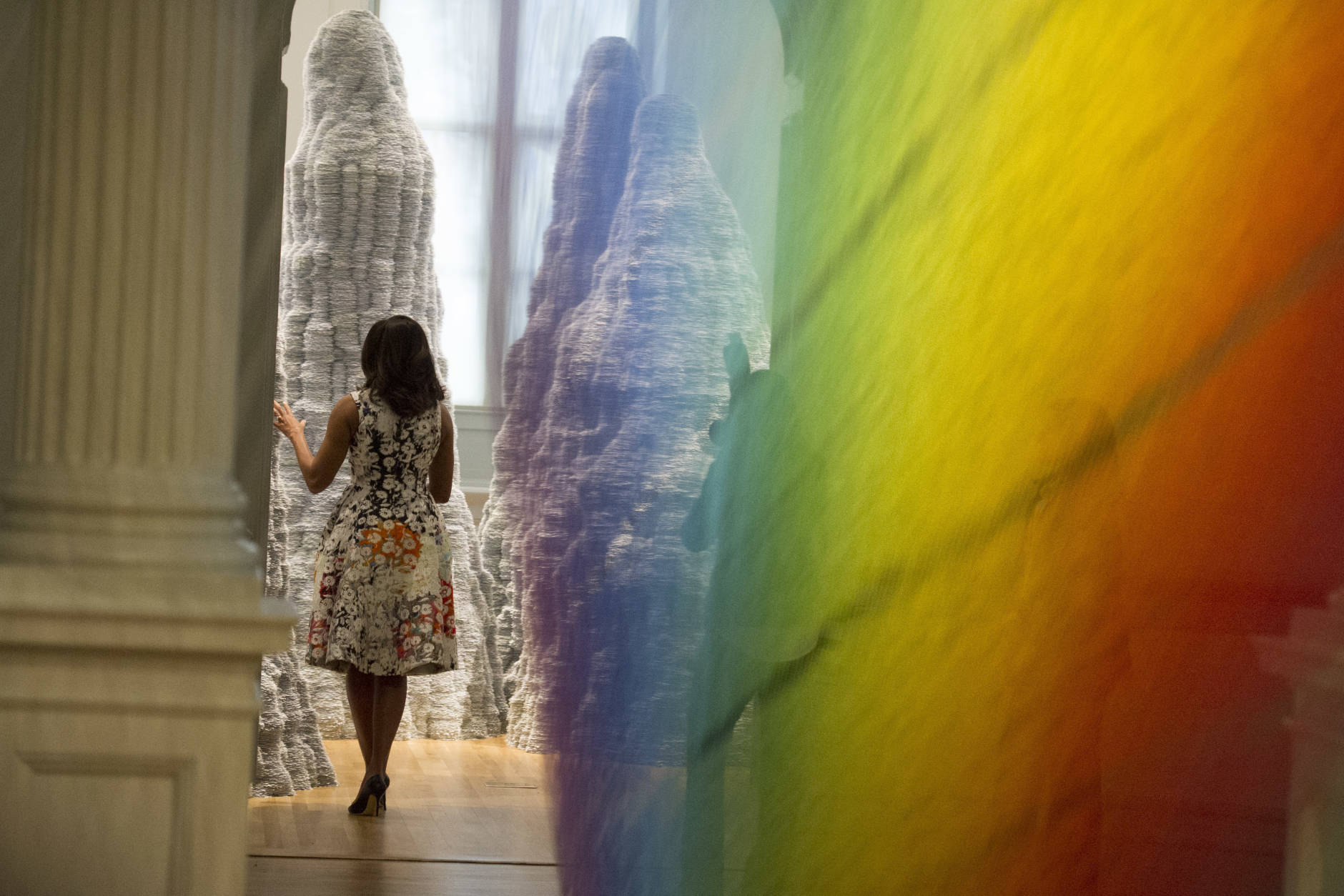 First lady Michelle Obama looks at the art installation Plexus A1 by Gabrial Dawe as she tours the Renwick Gallery in Washington, Friday, May 13, 2016, with the spouses of Nordic country leaders. (AP Photo/Cliff Owen)