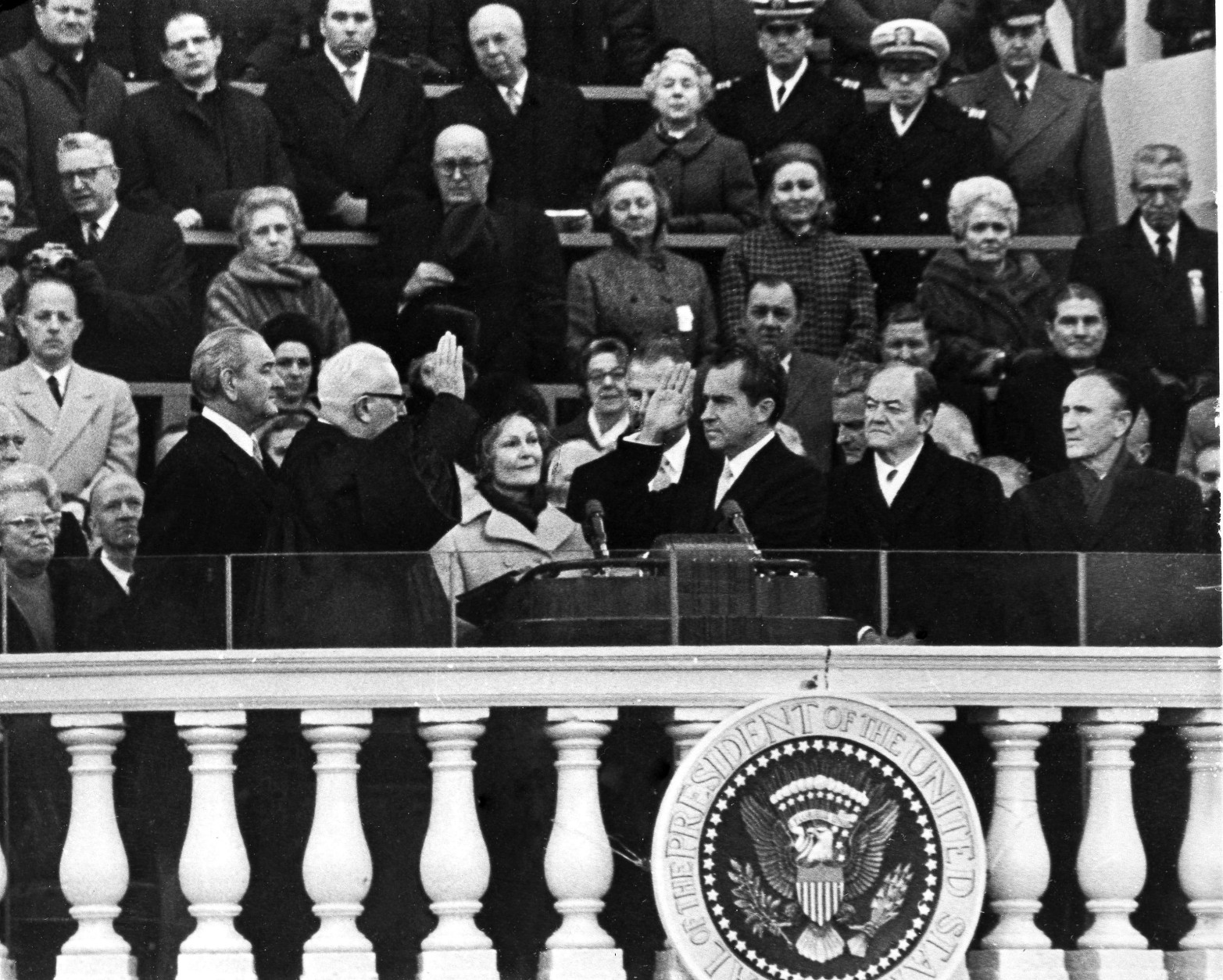 President Richard M. Nixon takes the oath of office from Chief Justice Earl Warren as his wife, Pat Nixon, holds two family bibles on the steps of the U.S. Capitol in Washington, Jan. 20, 1969. Former President Lyndon Johnson is beside Warren while Nixon is flanked by Vice President Spiro Agnew and former Vice President Hubert Humphrey, right. Lady Bird Johnson, the former president's wife is at extreme left, and Agnew's wife Judy is beside her. Sen. Mike Mansfield is at right. (AP Photo)