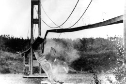 "FILE - In this Nov. 7, 1940 file photo, a large section of the concrete roadway in the centre span of the new Tacoma Narrows Bridge collapses into Puget Sound between Tacoma and the Kitsap Peninsula, Wa.. Known as ""Galloping Gertie"", the bridge became famous for twisting and bending like a ribbon before collapsing in a windstorm on Nov. 7, 1940, four months after opening. Still cited as one of the world's major engineering failures, the wreckage is now among the world's largest man-made reefs. (AP Photo/File)"
