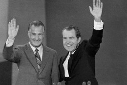 U.S. President Richard M. Nixon, right, and Vice-president Spiro T. Agnew wave to the Republican National Convention delegates in Miami, Fla., Aug. 23, 1972, who nominated them to run for re-election. (AP Photo)