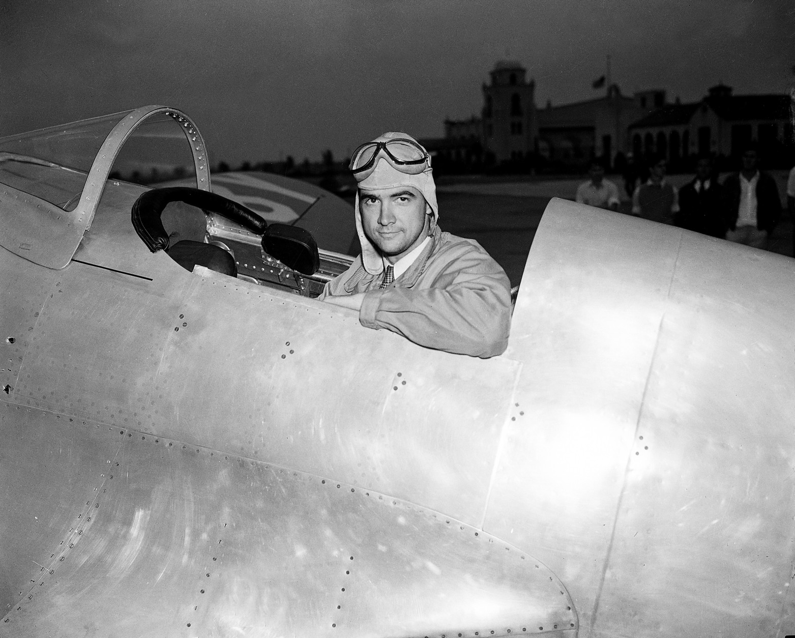 Howard Hughes, industrialist, film producer and pilot, poses in the cockpit of his new racing plane after a test flight in Los Angeles August 17, 1935.  The plane, nearly two years in construction at a cost believed to be more than $100,000, was to be piloted by Hughes in the Bendix race from Los Angeles to Cleveland. (AP Photo)