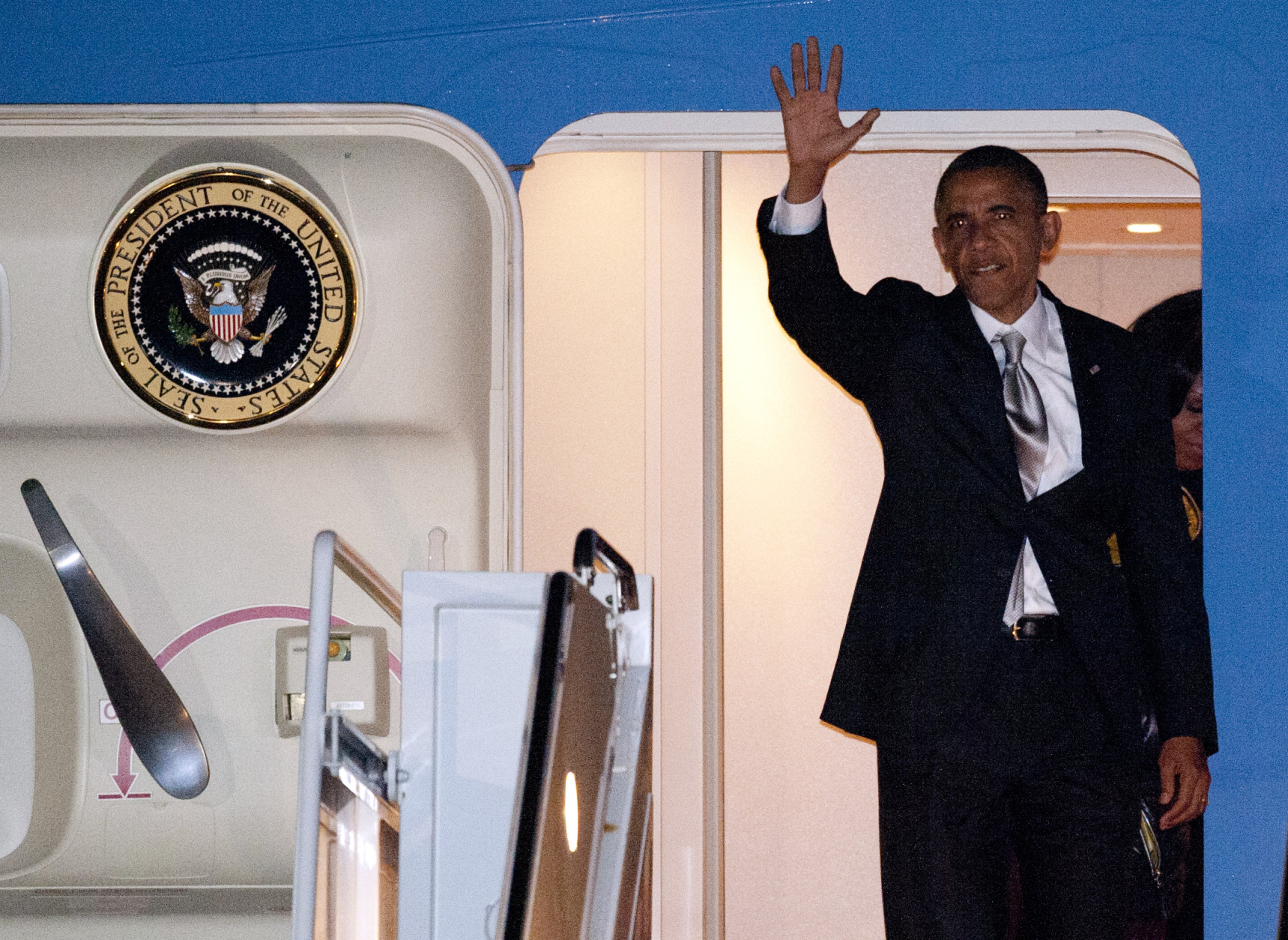 President Barack Obama exits Air Force One at Andrews Air Force Base, Md., the day after he was re-elected President, Wednesday, Nov. 7, 2012. (AP Photo/Cliff Owen)