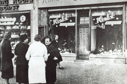 A group of people stand outside a Jewish-owned shop in an unnamed German town in November 1938, after the Kristallnacht, when Nazis thugs burned and plundered hundreds of Jewish homes, shops and synagogues across the country. November 9th is regarded a historic faithful day in Germany as on the same day in 1918 monarchy in Germany was overthrown, in 1939 it heralded the Holocaust and in 1989 it marked the fall of the Berlin Wall which resulted in the German reunification after 28 years of division. (AP Photos)