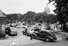 A long line of cars waiting to get the last gasoline on their temporary gas rationing cards is seen near the Capitol, July 21, 1942, in Washington.  (AP Photo)
