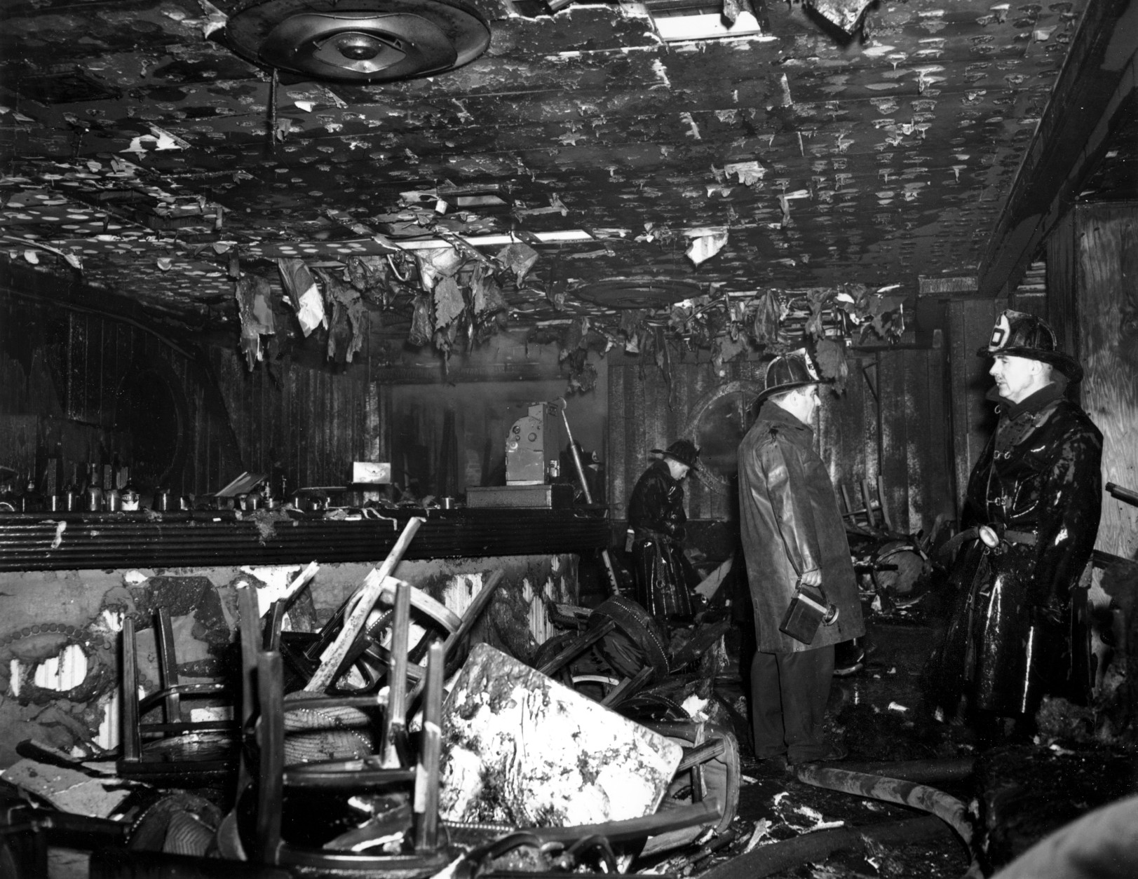 Firemen inspect the ruins of the Cocoanut Grove Night Club in Boston, Mass., on Nov. 28, 1942. A fire swept through the establishment at night, killing 492 persons. (AP Photo)