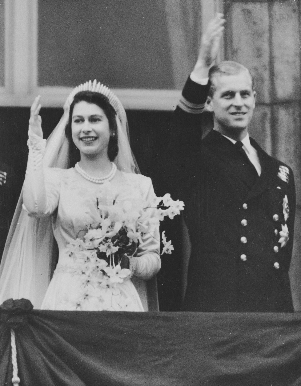 Princess Elizabeth and Prince Philip, the Duke of Edinburgh, wave to the crowds from a balcony of Buckingham Palace after their return from Westminster Abbey following their marriage, Nov. 20, 1947. (AP Photo)