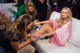 Lily Donaldson appears backstage in hair and makeup at the 2015 Victoria Secret Fashion Show at the Lexington Armory on Tuesday, Nov. 10, 2015, in New York. The Victoria's Secret Fashion Show will air on CBS on Tuesday, December 8th at 10pm EST. (Photo by Charles Sykes/Invision/AP)