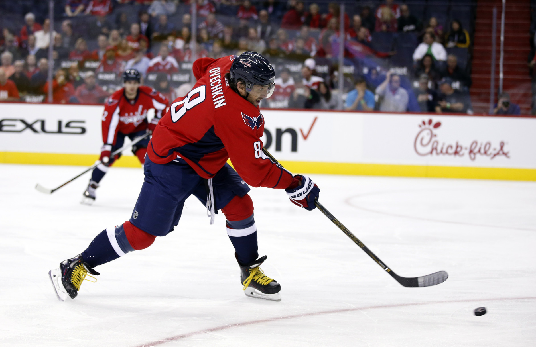 Washington Capitals left wing Alex Ovechkin (8), from Russia, shoots the puck in the first period of an NHL hockey game against the Dallas Stars, Thursday, Nov. 19, 2015, in Washington. (AP Photo/Alex Brandon)
