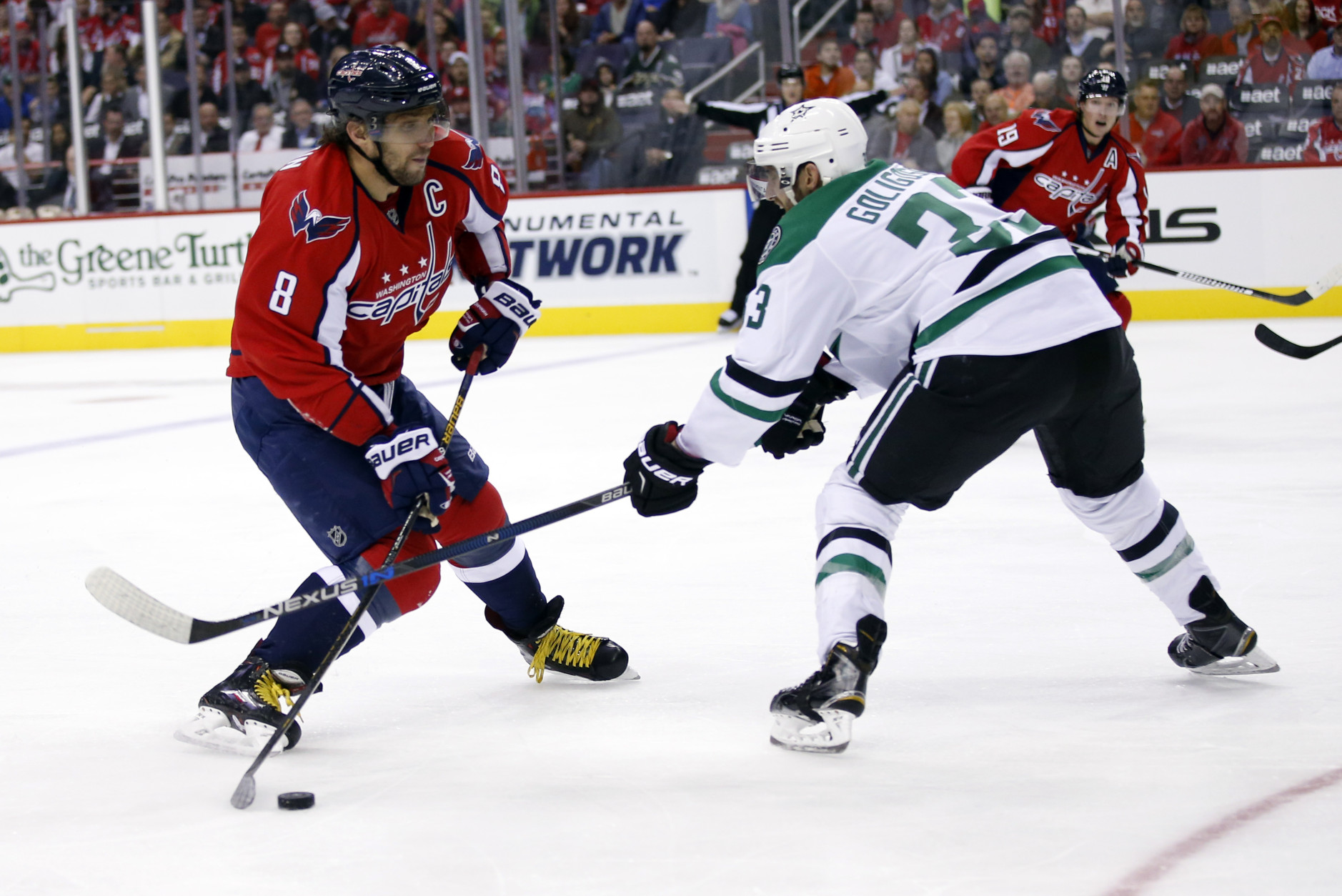 Washington Capitals left wing Alex Ovechkin (8), from Russia, has his shot blocked Dallas Stars defenseman Alex Goligoski (33) during the first period of an NHL hockey game, Thursday, Nov. 19, 2015, in Washington. (AP Photo/Alex Brandon)